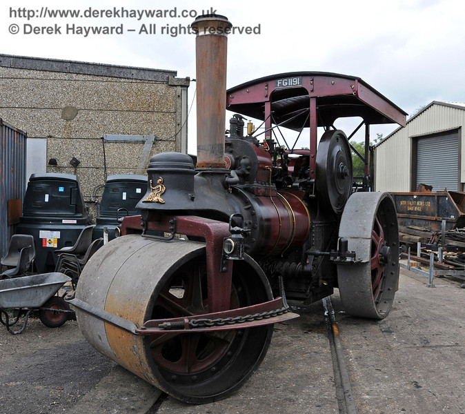 A traction engine alongside Sheffield Park shed. 06.08.2010
