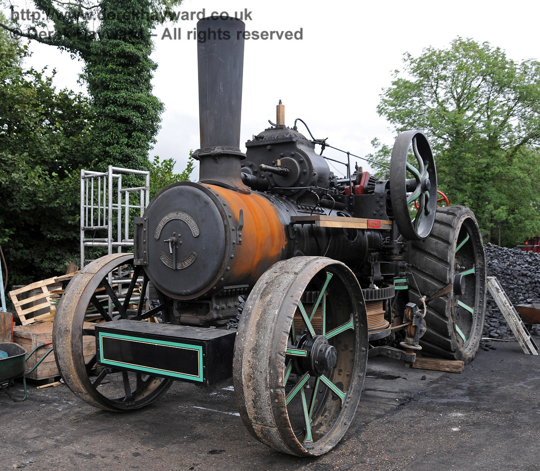 A traction engine adjacent to the coal heap at Sheffield Park shed. 06.08.2010   3568