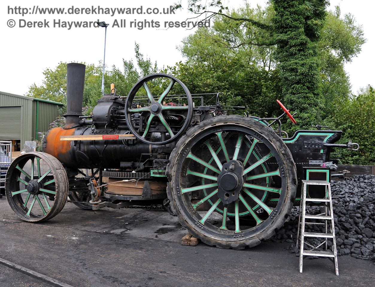 A traction engine adjacent to the coal heap at Sheffield Park shed. 06.08.2010   3569