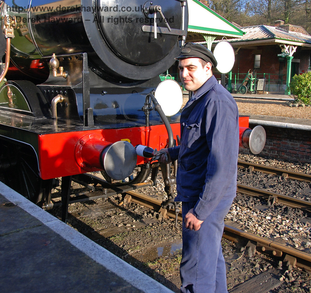 Ben Weatherall prepares to break the champagne. Horsted Keynes 30.01.2010  105