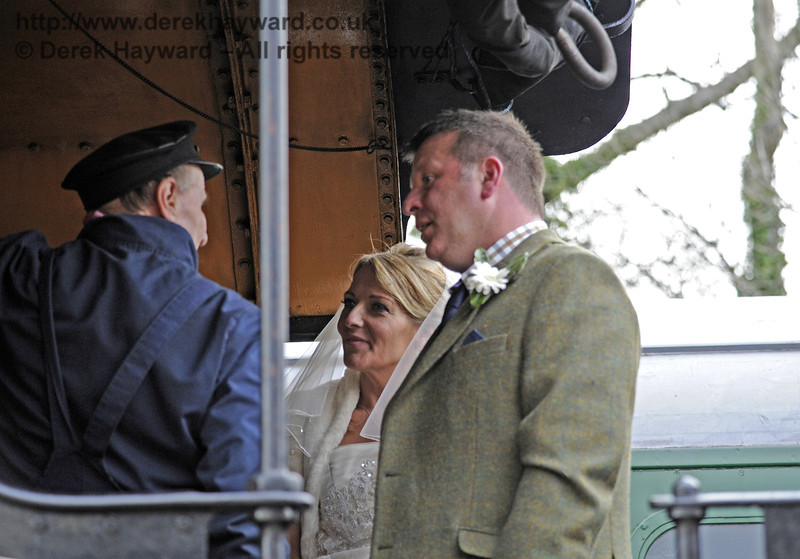 The bride and groom on board 847 at Sheffield Park.  05.04.2014  8912