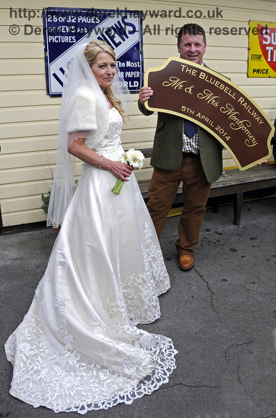 The newly married Jennifer and Sean Montgomery pose with the headboard from 847 at Sheffield Park Station.  05.04.2014  10286