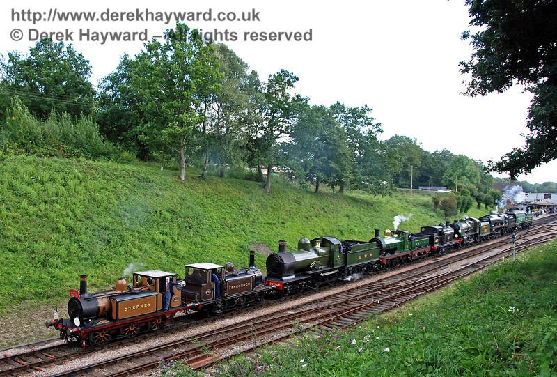Stepney, Fenchurch, 9017, 65, 32473, 1638, 34028 and 21C123 form the cavalcade through Horsted Keynes. 12.08.2007