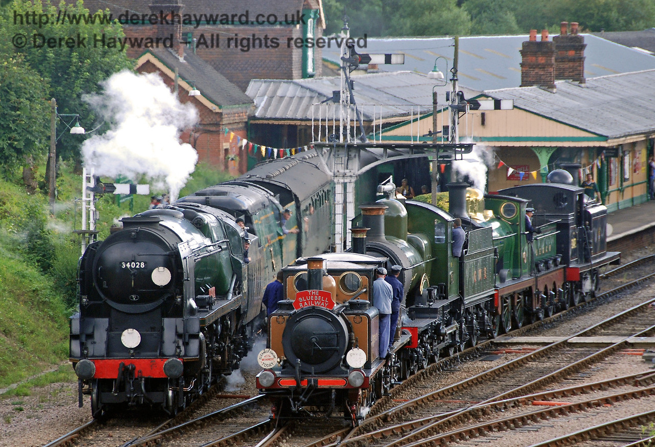 Bluebell at it's best. 34028 and 21C123 wait to leave with a Kingscote train, whilst other engines return from the cavalcade. Horsted Keynes 12.08.2007