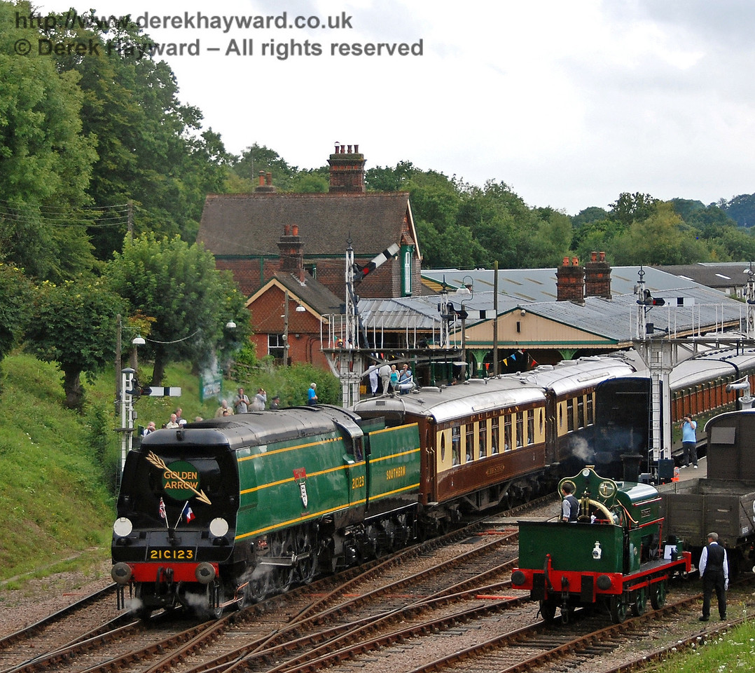 Little and Large. The crew of Sir Berkeley watch as 21C123 Blackmoor Vale passes with the Pullman. 12.08.2007