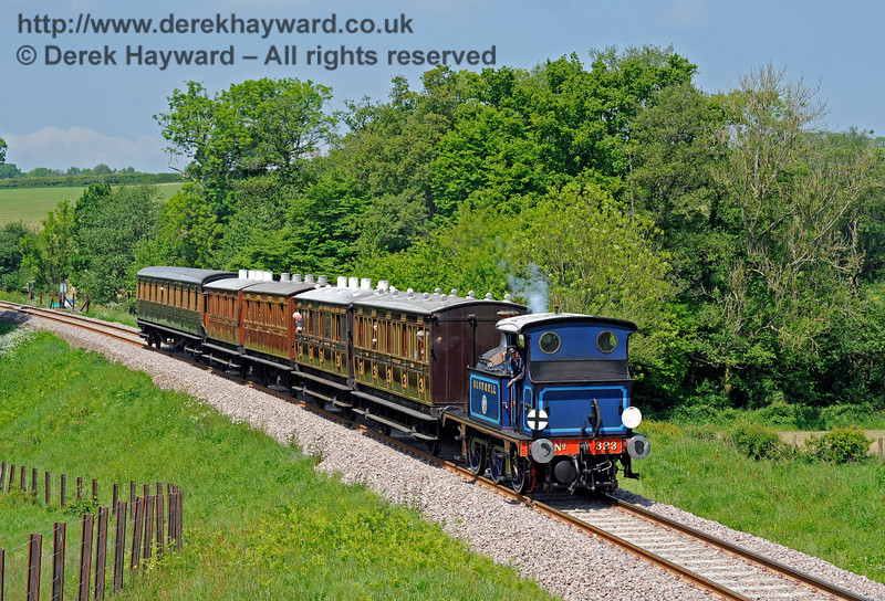 323 Bluebell heads south into Rock Cutting with a service train.  20.05.2018 16553