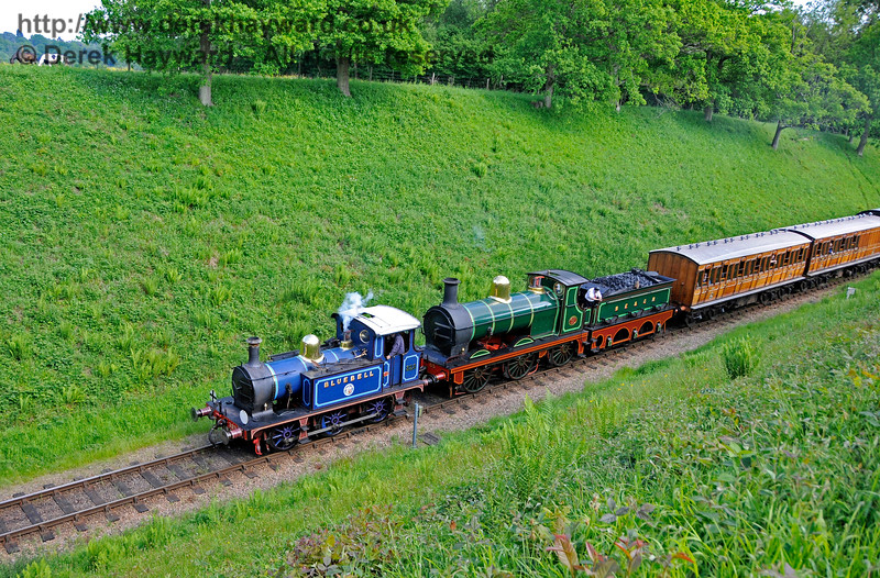 323 Bluebell and 65 in the cutting south of Three Arch Bridge.  20.05.2018 18454