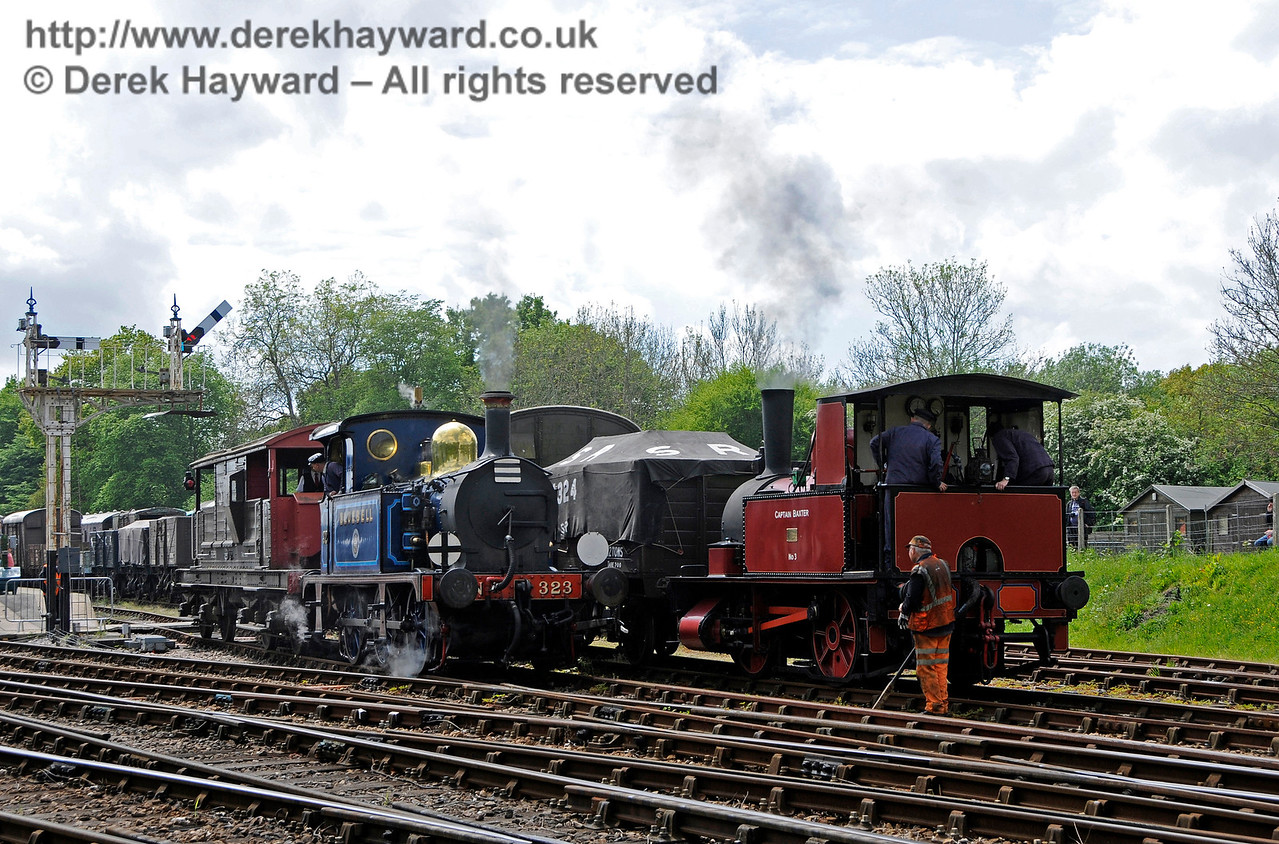 Watched by the Shunter, 323 Bluebell hauls a brake van from Platform 1 at Horsted Keynes, whilst Captain Baxter waits to restart the goods shunting. 13.05.2017 17173