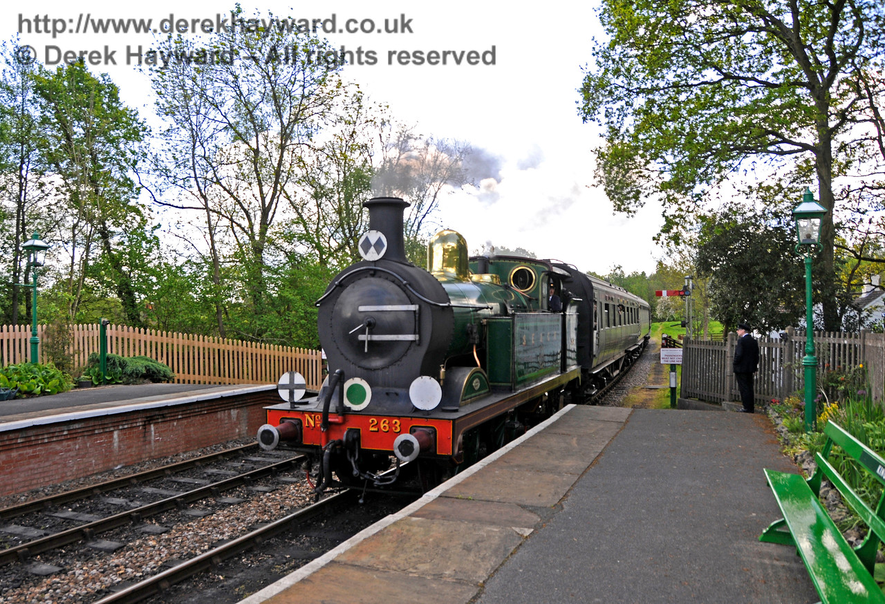 263 arriving at Kingscote.  The picture again catches the new shade of green on the seat. 14.05.2017 17197