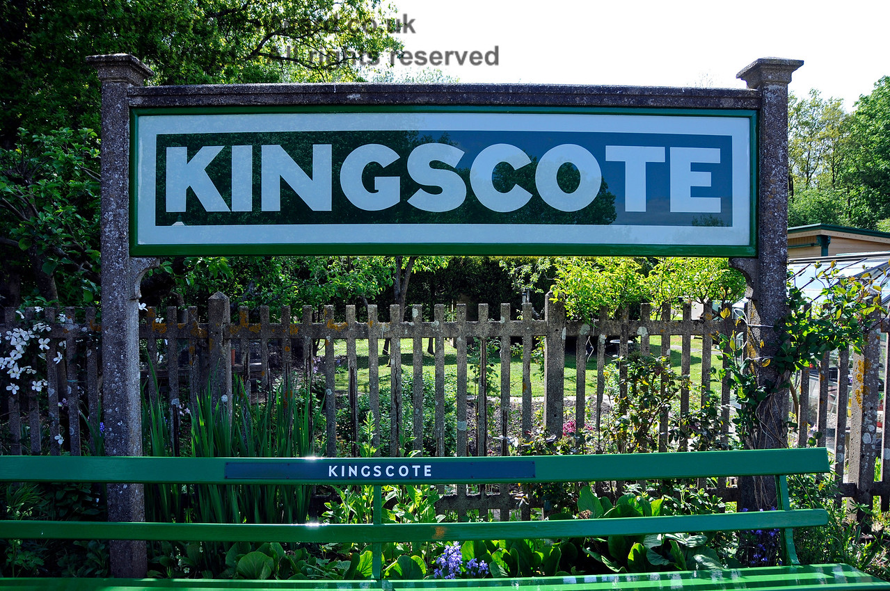The running In board at Kingscote, which was recently refurbished.  The picture also catches part of a seat painted in a new shade of green which is reported to be the correct shade for the station.   130517 17192