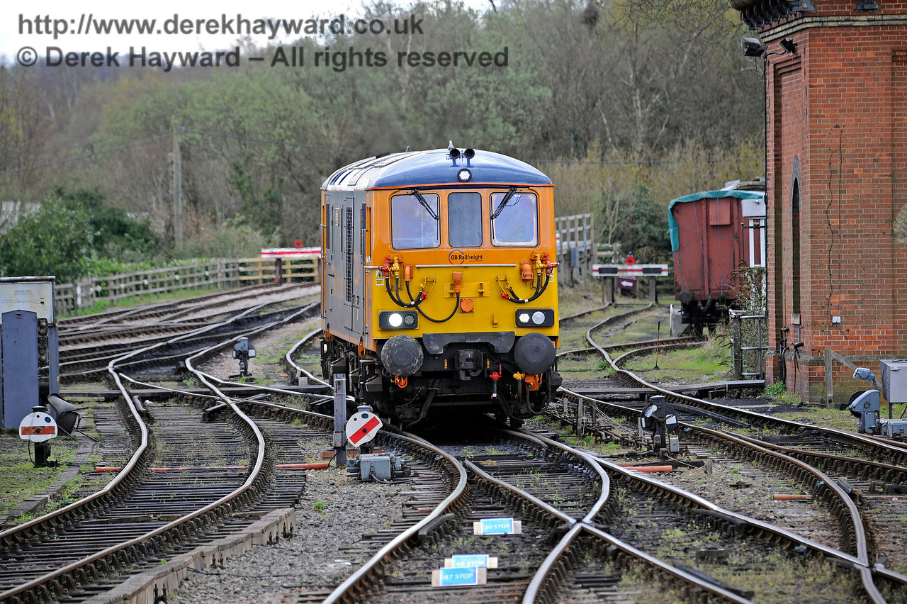 73964 runs round at Sheffield Park.  In the foreground are small blue signs indicating the point at which each class of locomotive should stop to ensure the train is correctly positioned in the station.  Bluebell Railway Diesel Gala, in association with GBRailfreight. 16.04.2016  12798