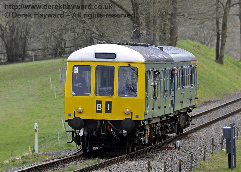 The DMU approaches Kingscote with a northbound service.  21.03.2014  8763