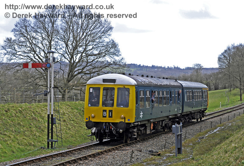 The DMU passes the Kingscote Advance Starter with a northbound service.  21.03.2014  8768