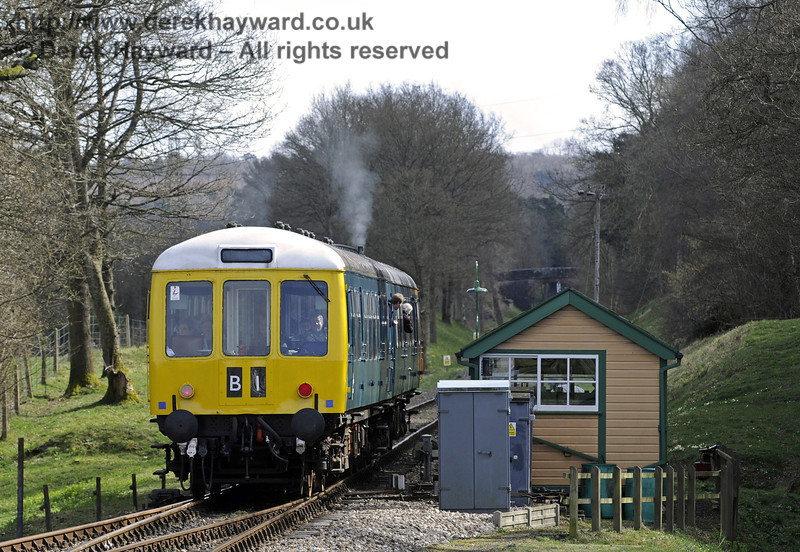 The DMU at Kingscote south signal box.  21.03.2014  8781