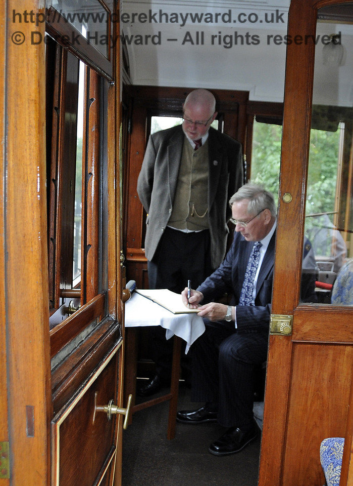 The Duke of Gloucester signs the Visitors Book to mark his visit to the Bluebell Railway, watched by Russell Pearce, Company Secretary.  10.10.2013  8300