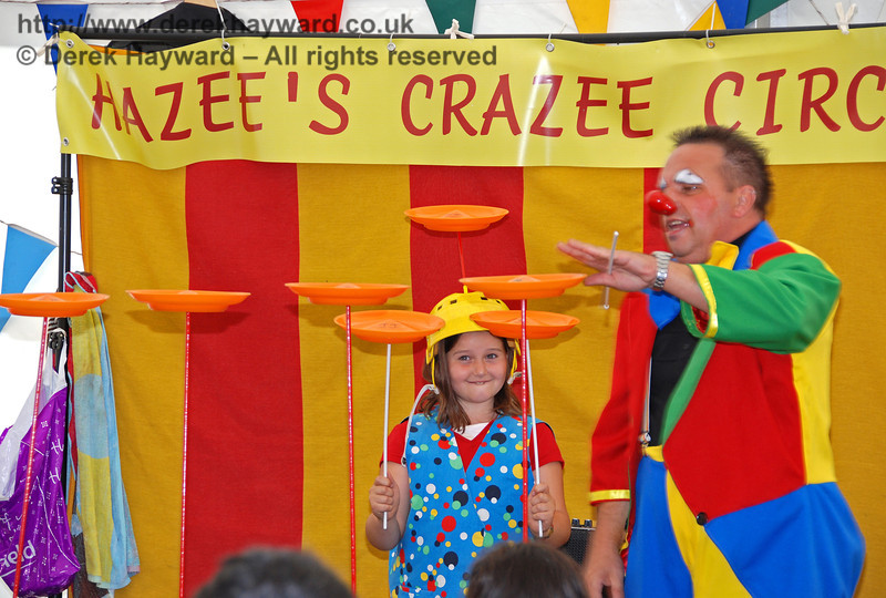 Give the young lady a big hand - seven plates in the air at once.... Really Great!! Hazee's Crazee Circus. Family Fun Weekend Horsted Keynes 29.06.2008