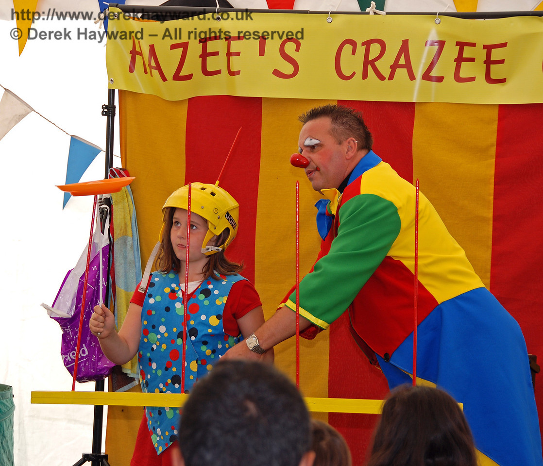 Now, transfer it to one of the rods on the table, and keep it spinning... Hazee's Crazee Circus. Family Fun Weekend Horsted Keynes 29.06.2008