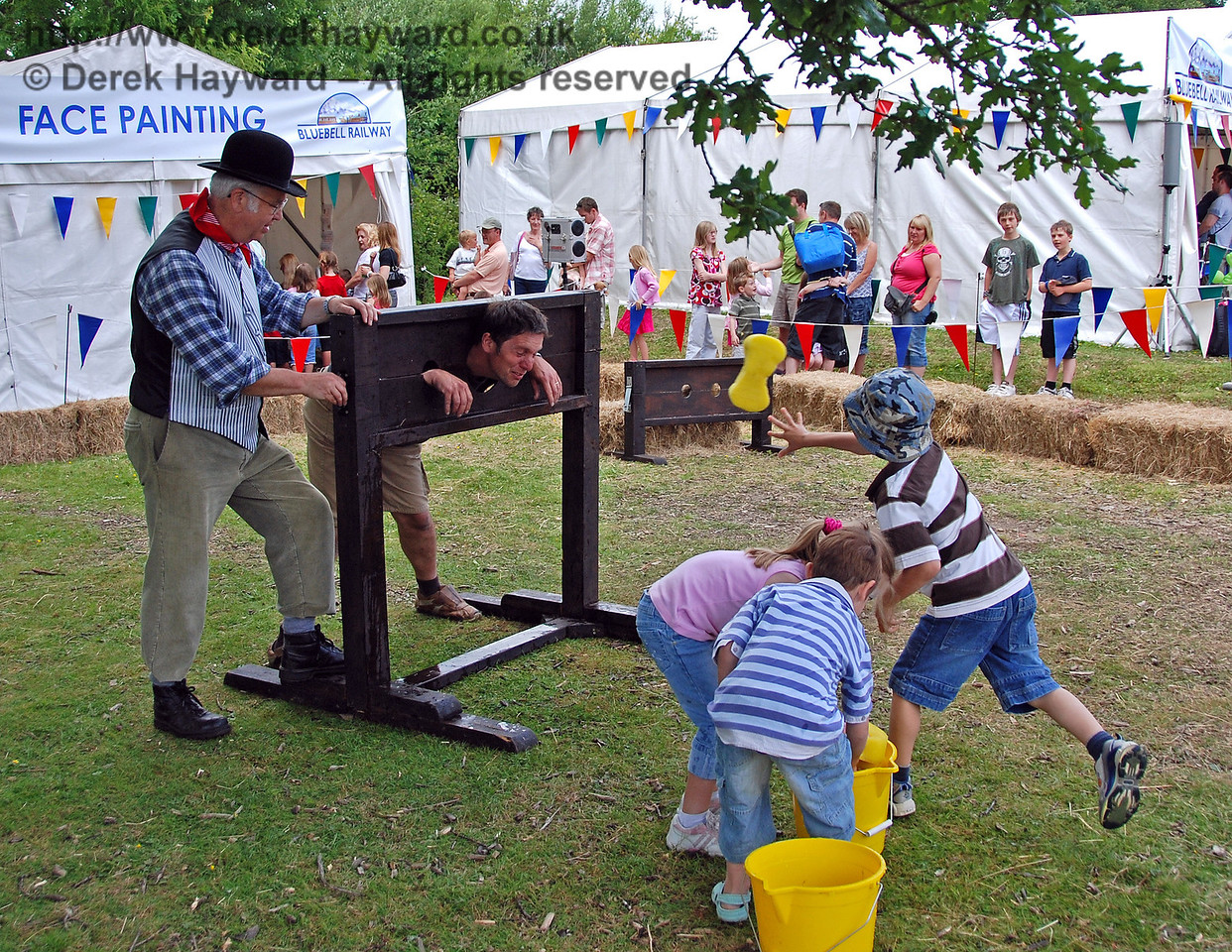 Another willing customer receives a very large wet sponge. Family Fun Weekend Horsted Keynes 29.06.2008