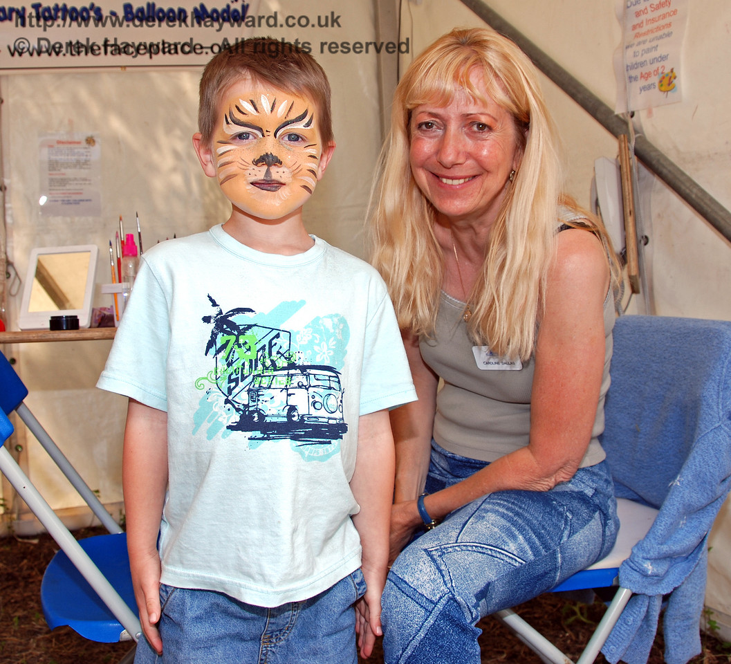 One of the expert face painters with a satisfied customer. Family Fun Weekend Horsted Keynes 29.06.2008