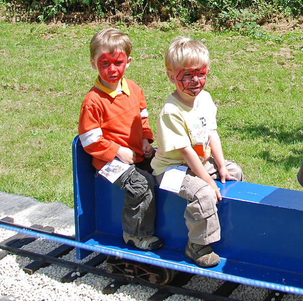 These passengers on the miniature railway at Kingscote could possibly have visited the face painting tent at Horsted Keynes... The Family Fun Weekend 22.06.2008