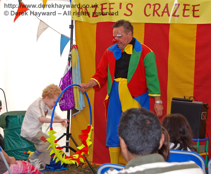 Jumping through the burning rings at Hazee's Crazee Circus. Family Fun Weekend Horsted Keynes 29.06.2008