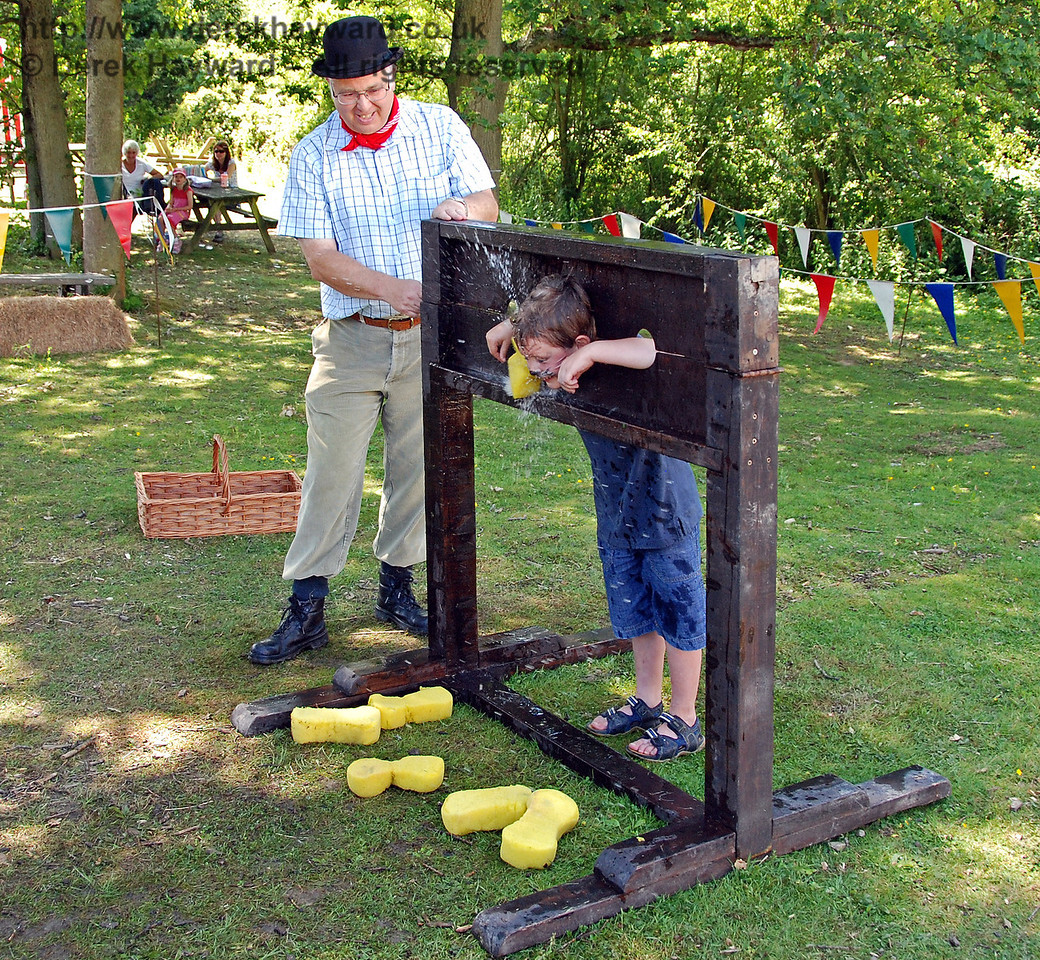 A very soggy customer in the stocks. Note the splash as the sponge makes contact and the number already thrown...  Horsted Keynes 27.06.2009