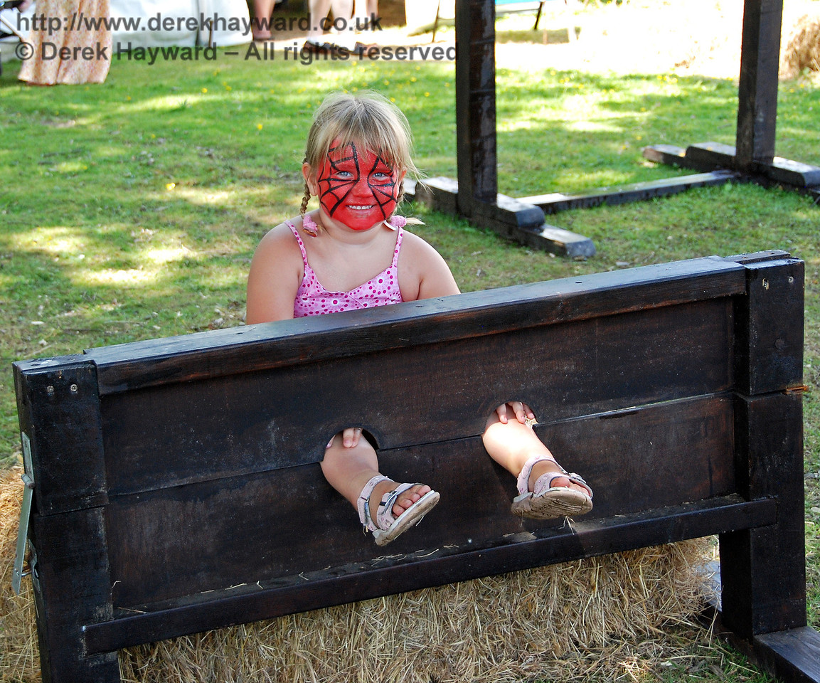 Fresh from the face painting, the next stop was the stocks. Horsted Keynes 27.06.2009