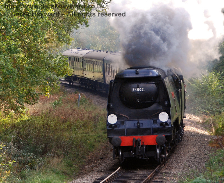 34007 Wadebridge rounds the curve into Lindfield Wood. 19.10.2007