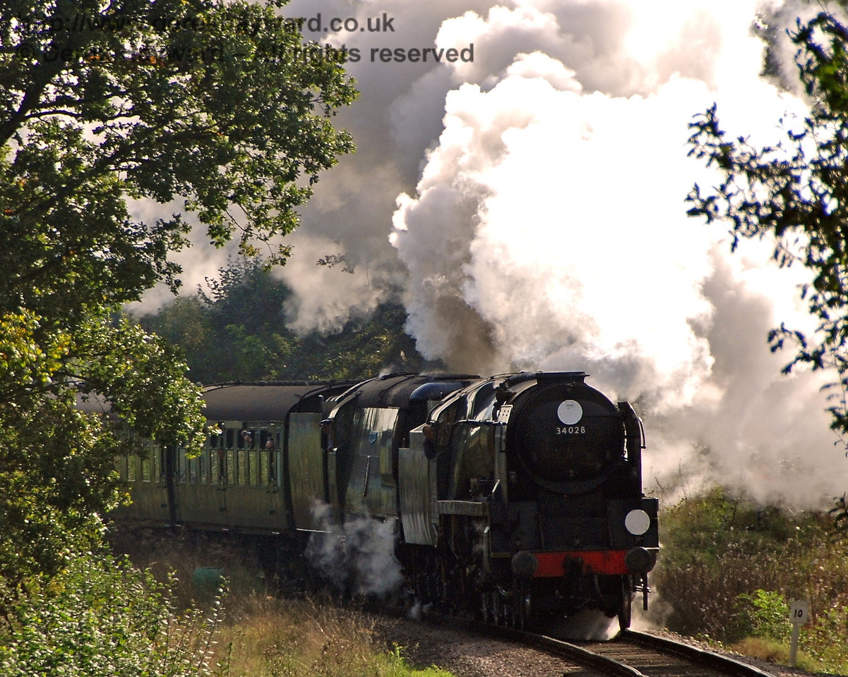 Sunlight catches the steam as 34028 Eddystone and 34081 92 Squadron pass through the cutting north of Caseford Bridge. 19.10.2007