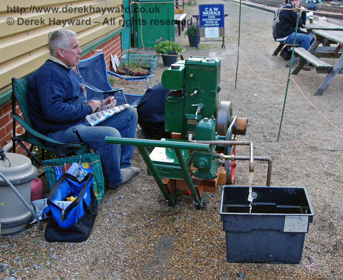 A stationary engine pumps water whilst it's owner waits to answer questions. Horsted Keynes 20.10.2007