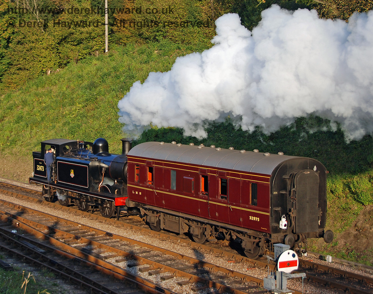 32473 hauls the LMS Footplate Days and Ways Brake Van north from Horsted Keynes. 19.10.2007