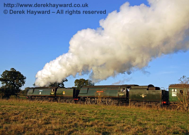 34081 92 Squadron and 34007 Wadebridge steam north towards Ketches Halt. 20.10.2007