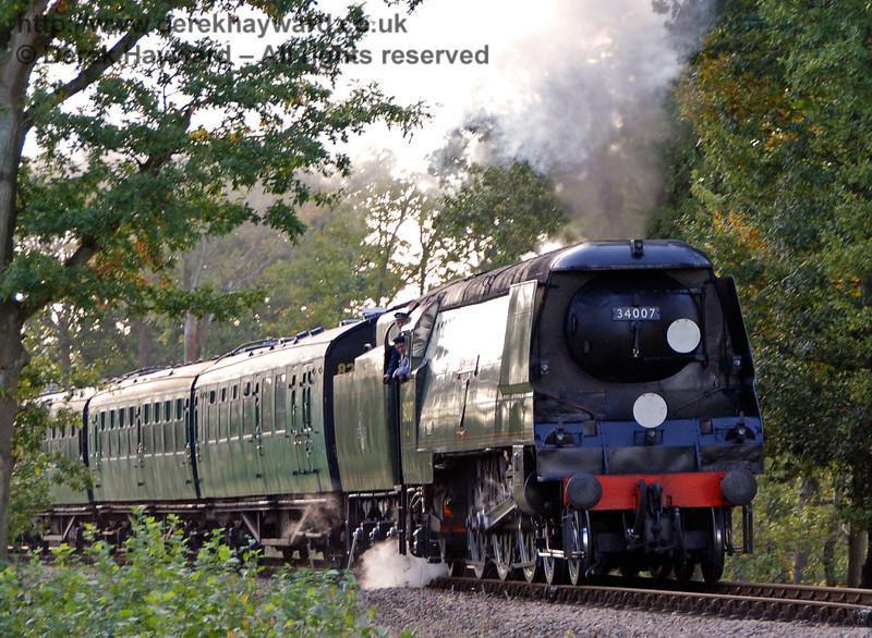 34007 Wadebridge steams north from Caseford Bridge. 19.10.2007