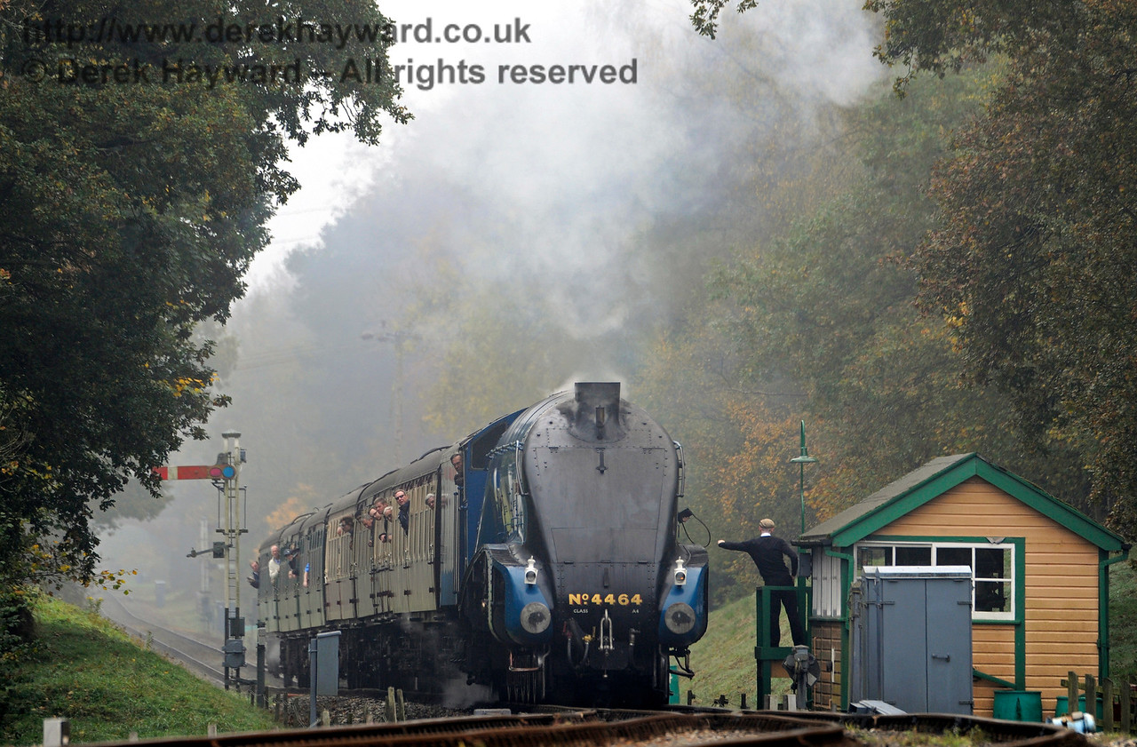 A foggy morning as 4464 Bittern surrenders the single line token at Kingscote south signal box.  01.11.2015  12438