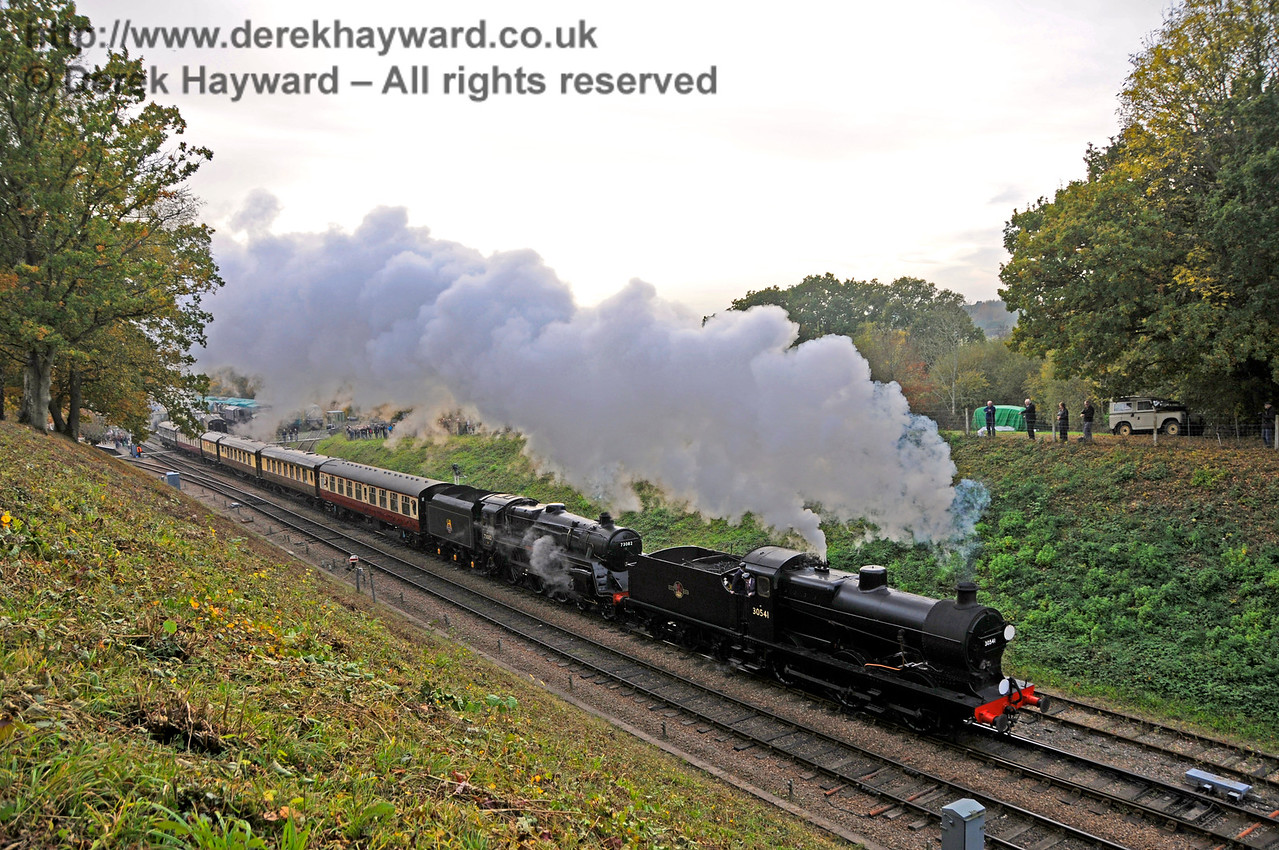 30541 and 73082 steam north from Horsted Keynes.  30.10.2016 16644