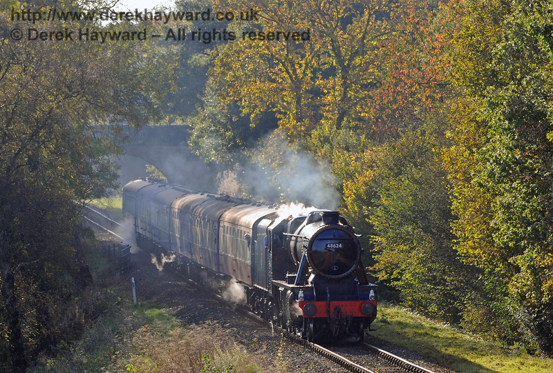 The steam heating appears to be leaking slightly as 48624 takes an early morning train through the mist hanging near Birchstone Bridge.  28.10.2016 14303