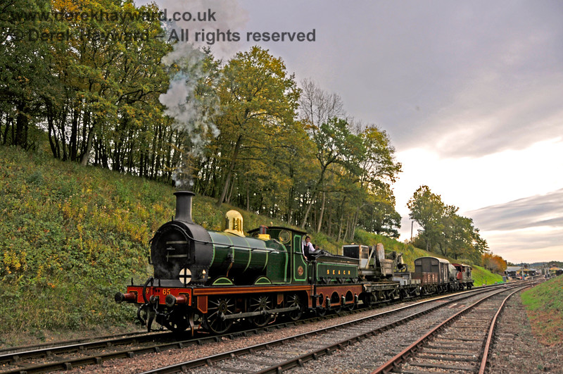 The light is fading as 65 trundles through Horsted Keynes with the last goods working of the day. 13.10.2018 18958
