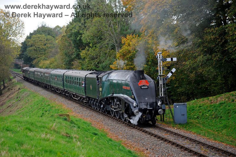 60009 passes the Kingscote northbound Home signals. 13.10.2018 16754