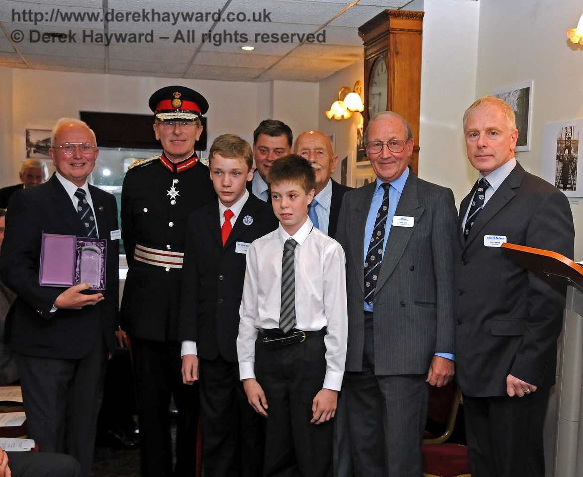 Charles Hudson, MBE, proudly holds the Queen's Award for Voluntary Service after the presentation. Also pictured are Her Majesty's Lord Lieutenant for East Sussex, Mr Peter Field, Paul Booth, 9F Club, Chris Cooper, Trustee BRPS, Lewis Backus, 9F Club, Sam Bee, Vice Chairman BRPS, and Roy Watts, Chairman BRPS. Sheffield Park 16.09.2010