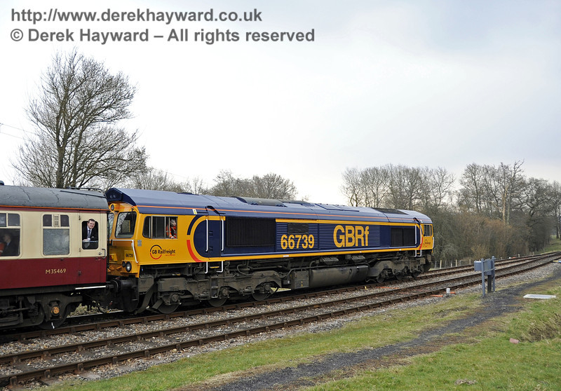 Class 66, 66739 runs south from Kingscote at the head of the incoming rail tour.  28.03.2013  6311