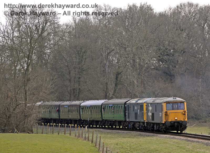 "The two Class 73 locomotives, 73207 and 73119 ""Borough of Eastleigh"", spent the day hauling a special train between Sheffield Park and East Grinstead.  It is seen here just north of Three Arch Bridge.  28.03.2013  8608"