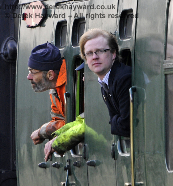 Two members of staff look out from a service train approaching Horsted Keynes.  28.03.2013  8593