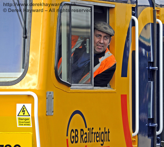 Phil Gain minds the engine at Horsted Keynes.  28.03.2013  8601