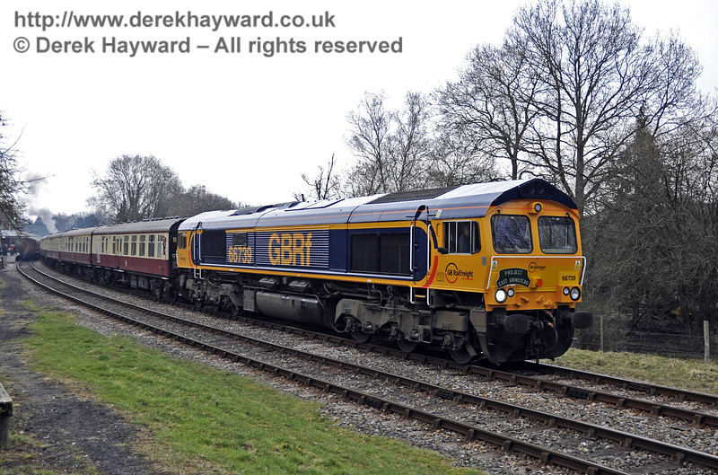 Class 66, 66739 runs south from Kingscote at the head of the incoming rail tour.  28.03.2013  6310