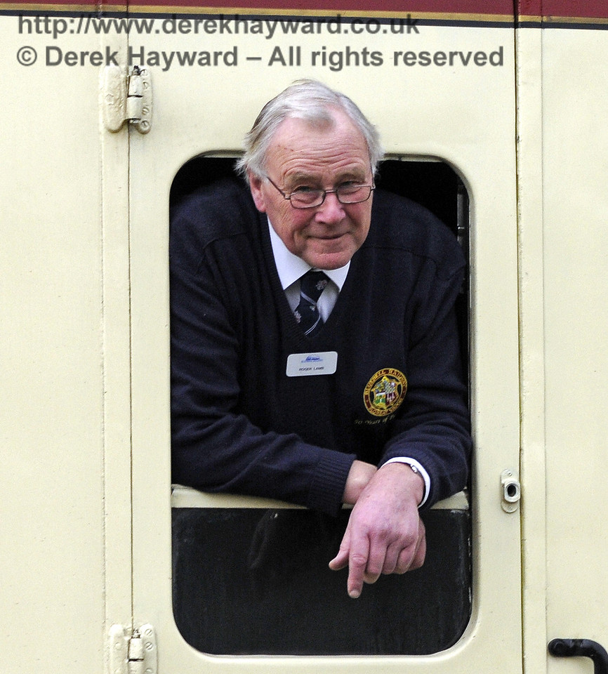 Bluebell volunteer Roger Lamb watches from the window of the train.  28.03.2013