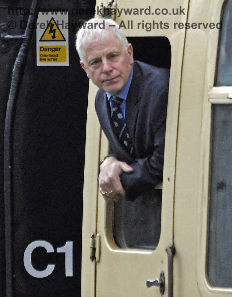 Roy Watts, Chairman BRPS, looks out of the window of the special as it passes through Kingscote. 28.03.2013  8568
