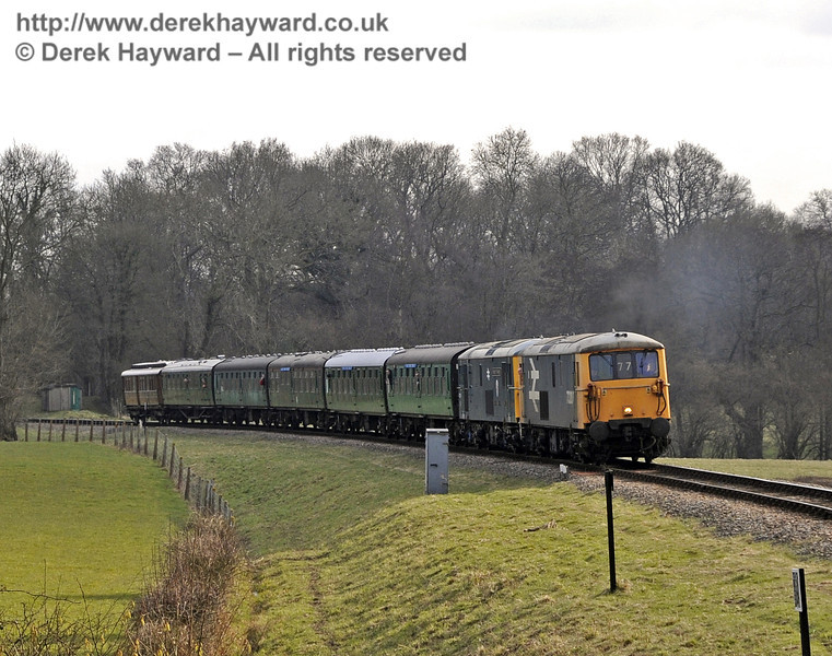 "The two Class 73 locomotives,73207 and 73119 ""Borough of Eastleigh"",  spent the day hauling a special train between Sheffield Park and East Grinstead.  It is seen here approaching New Road Bridge.  28.03.2013  6447"