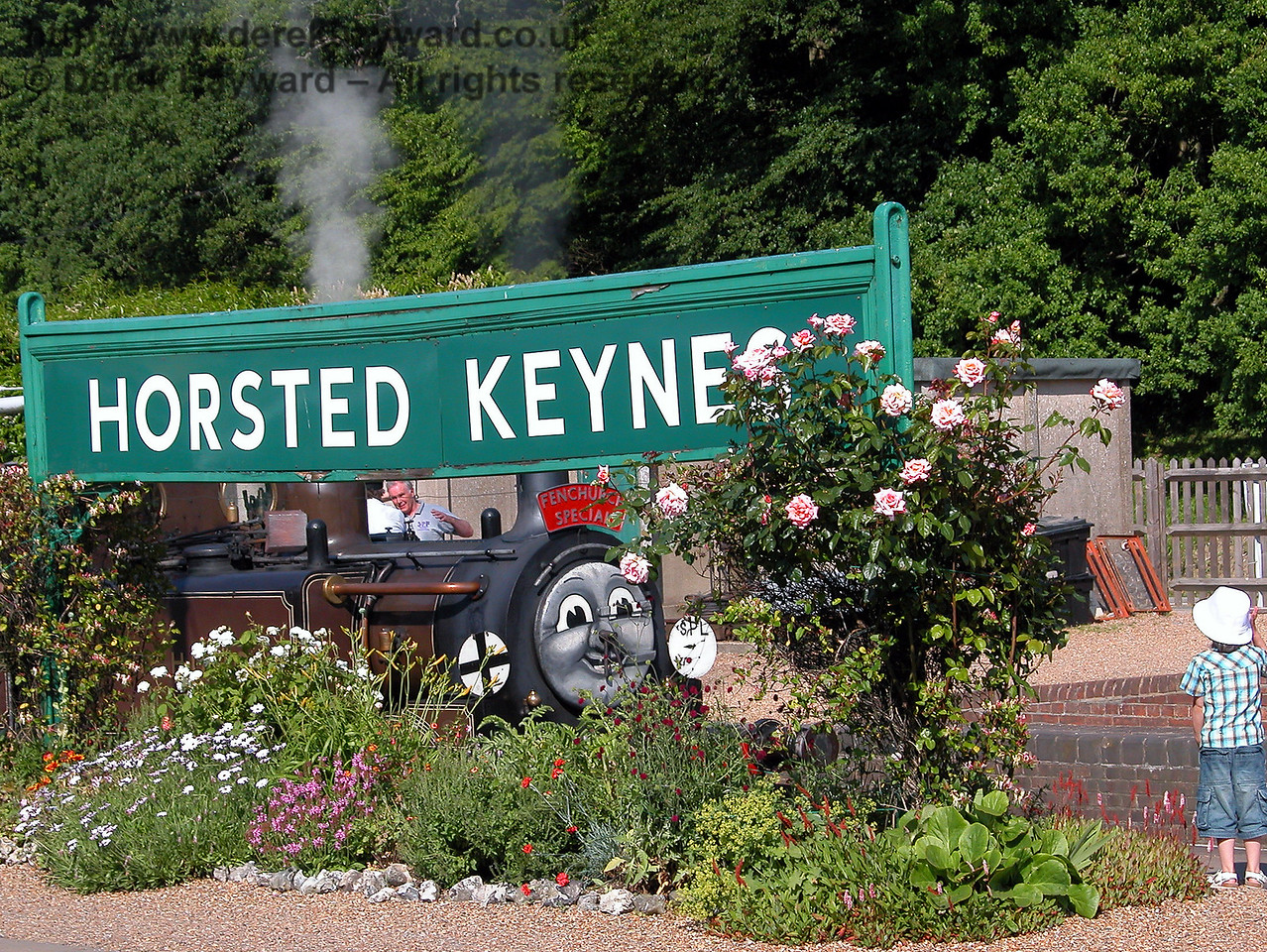 Fenchurch decides to play hide-and-seek behind the flowers, but a young admirer soon finds him.  Horsted Keynes 24.06.2006