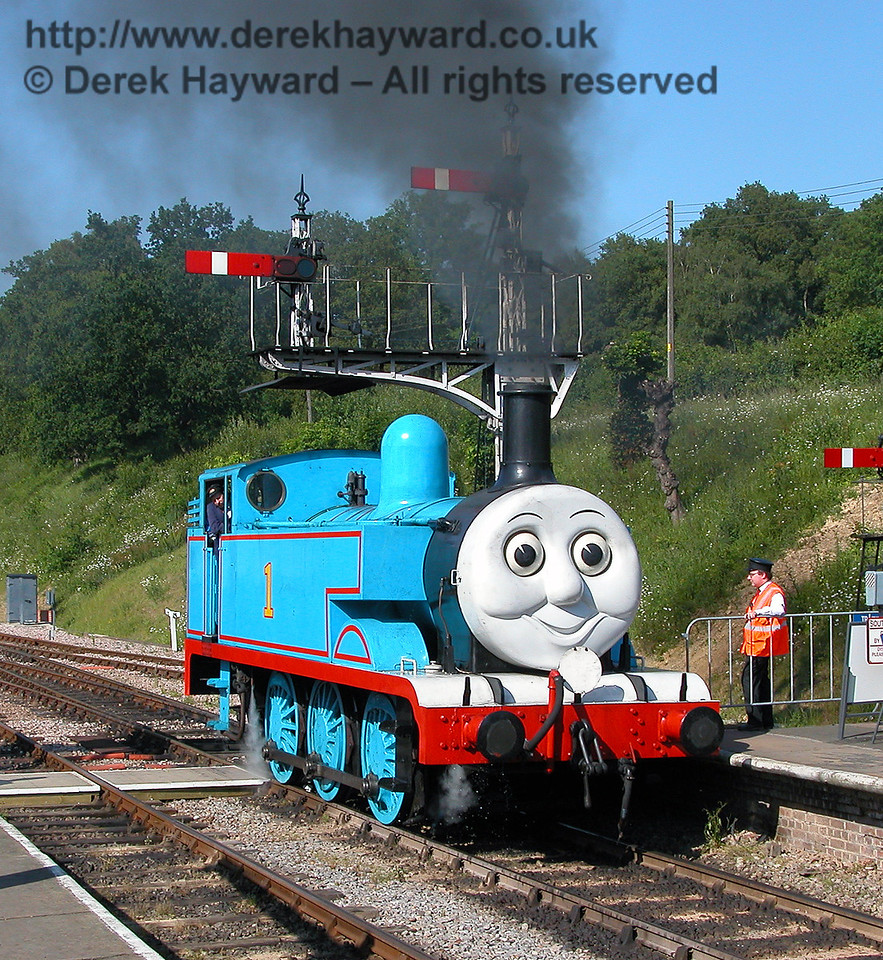 Thomas stops to talk to the man at the end of Horsted Keynes platform 24.06.2006.