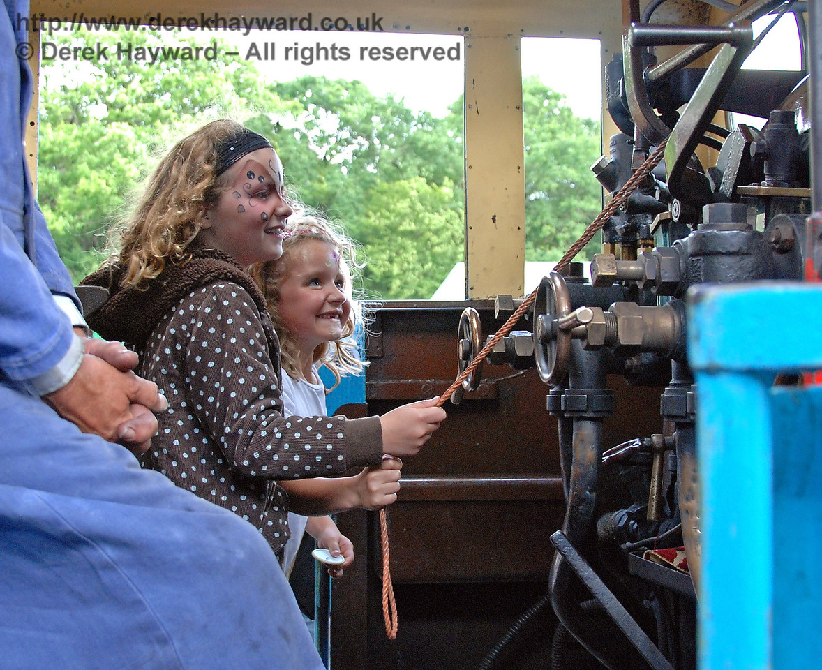 Having obviously visited the face painting tent, these two young ladies have great fun sounding the whistle on board Thomas. Horsted Keynes 01.07.2007